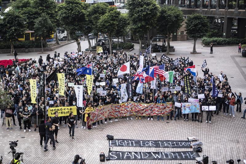 圖為港人要求國際社會對民主運動進行支持。(余鋼/大紀元)