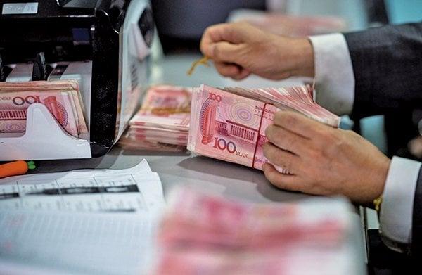 數據顯示,大陸5月份央行口徑外匯佔款連降10個月。(AFP)