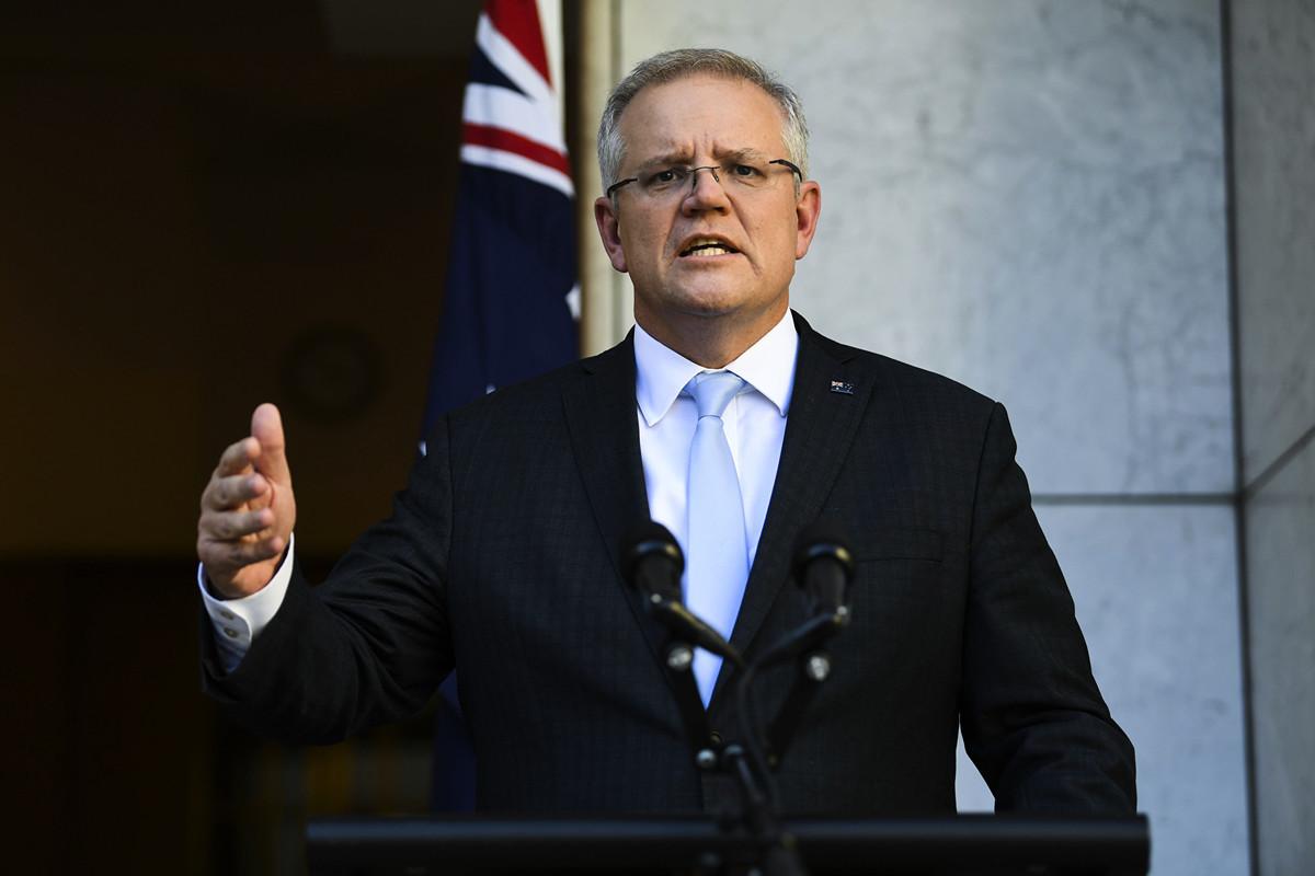 澳洲總理莫里森2020年3月19日宣佈,將從20日(周五)晚9點起關閉邊境,除澳洲公民和永久居民外,所有外國人不得進入澳洲。(AAP Image/Lukas Coch)