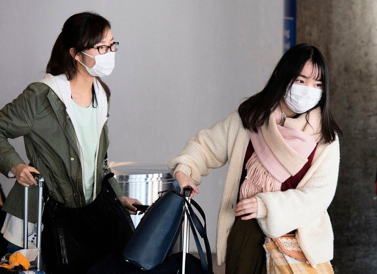 2020年02月中共肺炎疫情不斷升級,各國在紛紛採取入境限制措施。(MARK RALSTON/AFP via Getty Images)
