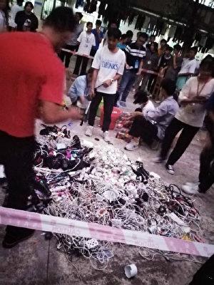 廣西物資學校學生會集體毀壞從學生手裏收繳的電器。(網絡圖片)