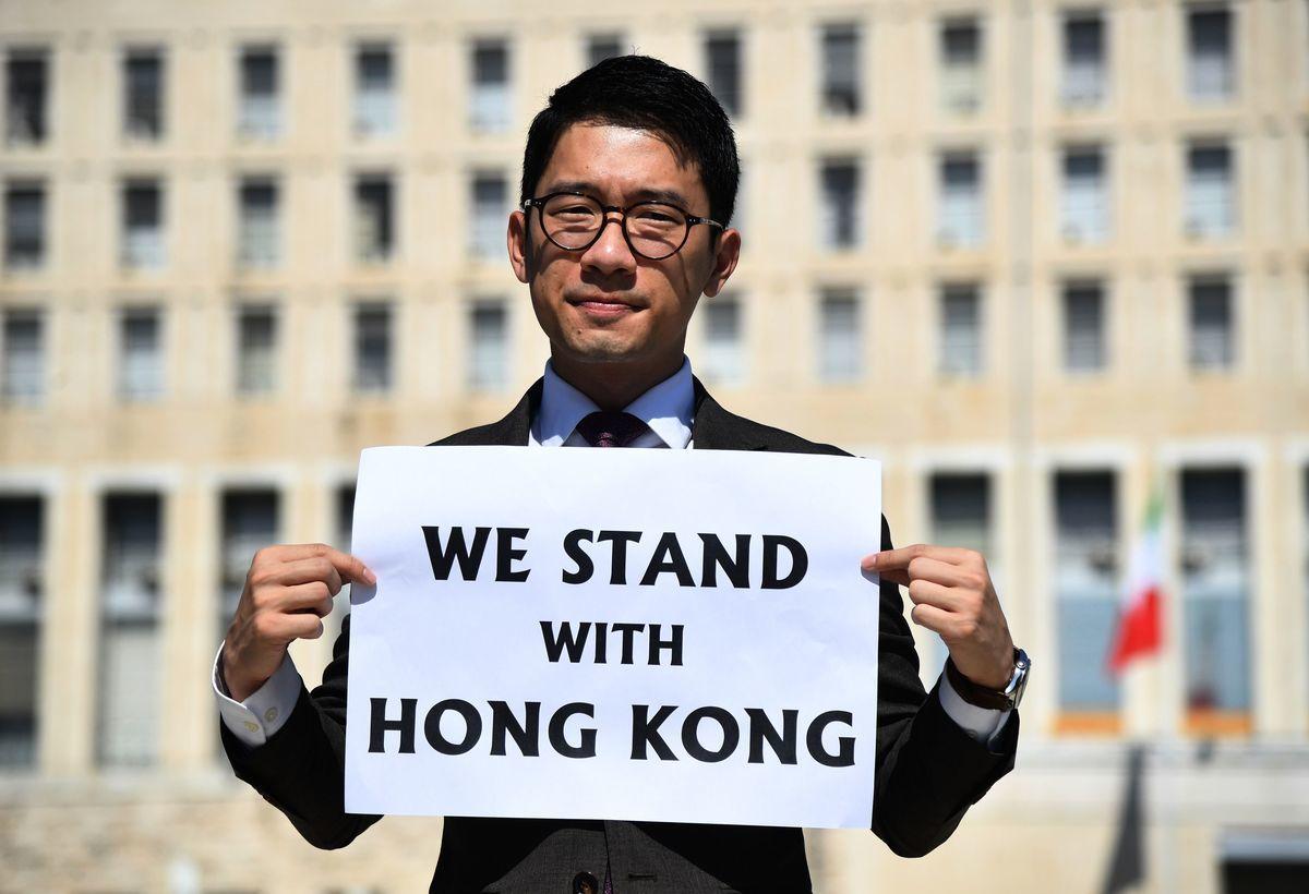 美國《時代》(TIME)雜誌今年公佈風雲人物入圍名單「讀者票選」結果,由「香港眾志」前主席羅冠聰取得第一,這是繼去年「香港(反送中)抗爭者」後,連續第二年由香港人奪得「讀者」票選第一。(TIZIANA FABI/AFP via Getty Images)