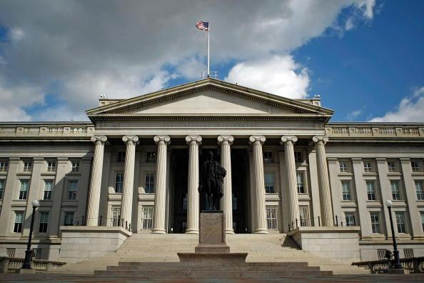 美國財政部7月31日宣佈,凍結新疆生產建設兵團以及兩名高官的資產,限制這兩名高官入境。(美國財政部網站截圖)