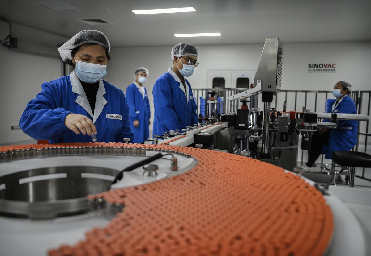 中共想借助台商的力量,獲得大量專利與技術,重組紅色供應鏈。(Kevin Frayer/Getty Images)