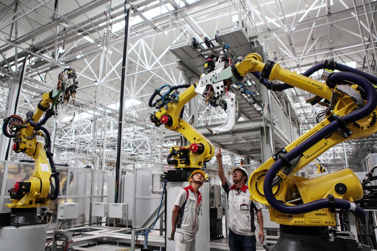中印衝突使得華為和長城汽車等中國公司在印度的業務受到衝擊。圖為長城汽車位於重慶的一家工廠的工作現場。(STR/AFP/China OUT)