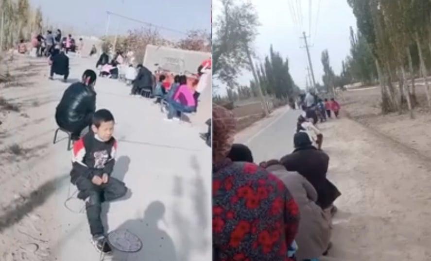 新疆喀什疫情爆發後,10月25日24時起,喀什地區四個鄉鎮被定為高風險地區。圖為當地民眾排隊做核酸檢測。(影片截圖合成)