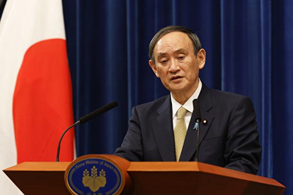 圖為日本首相菅義偉。(RODRIGO REYES MARIN/POOL/AFP via Getty Images)