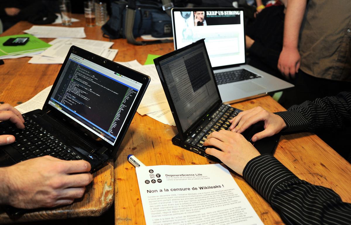 中共間諜活動引起廣泛關注。圖為黑客示意圖。(PHILIPPE HUGUEN / AFP)