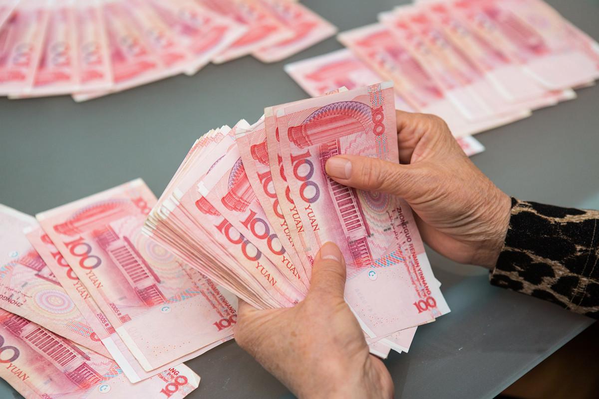 中共內部對貨幣政策發出不同聲音。人民幣示意圖。(Benjamin Chasteen/大紀元)