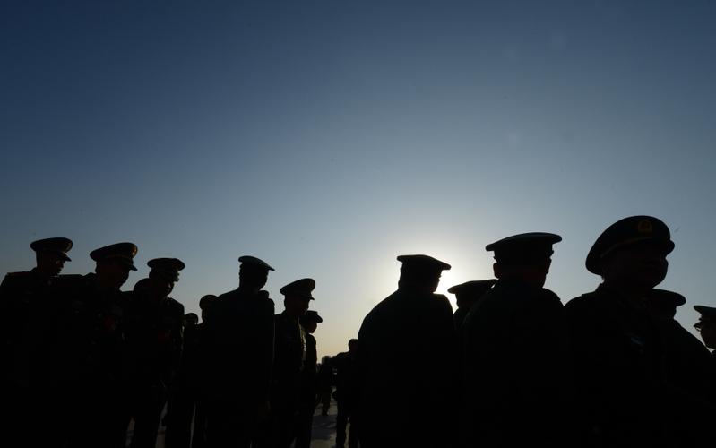 雖然多種資源大力被投入國防事務,但中共軍事能力最大障礙就是缺乏訓練有素的中共軍隊人員,尤其是高級軍事領導人。(MARK RALSTON/AFP/Getty Images)