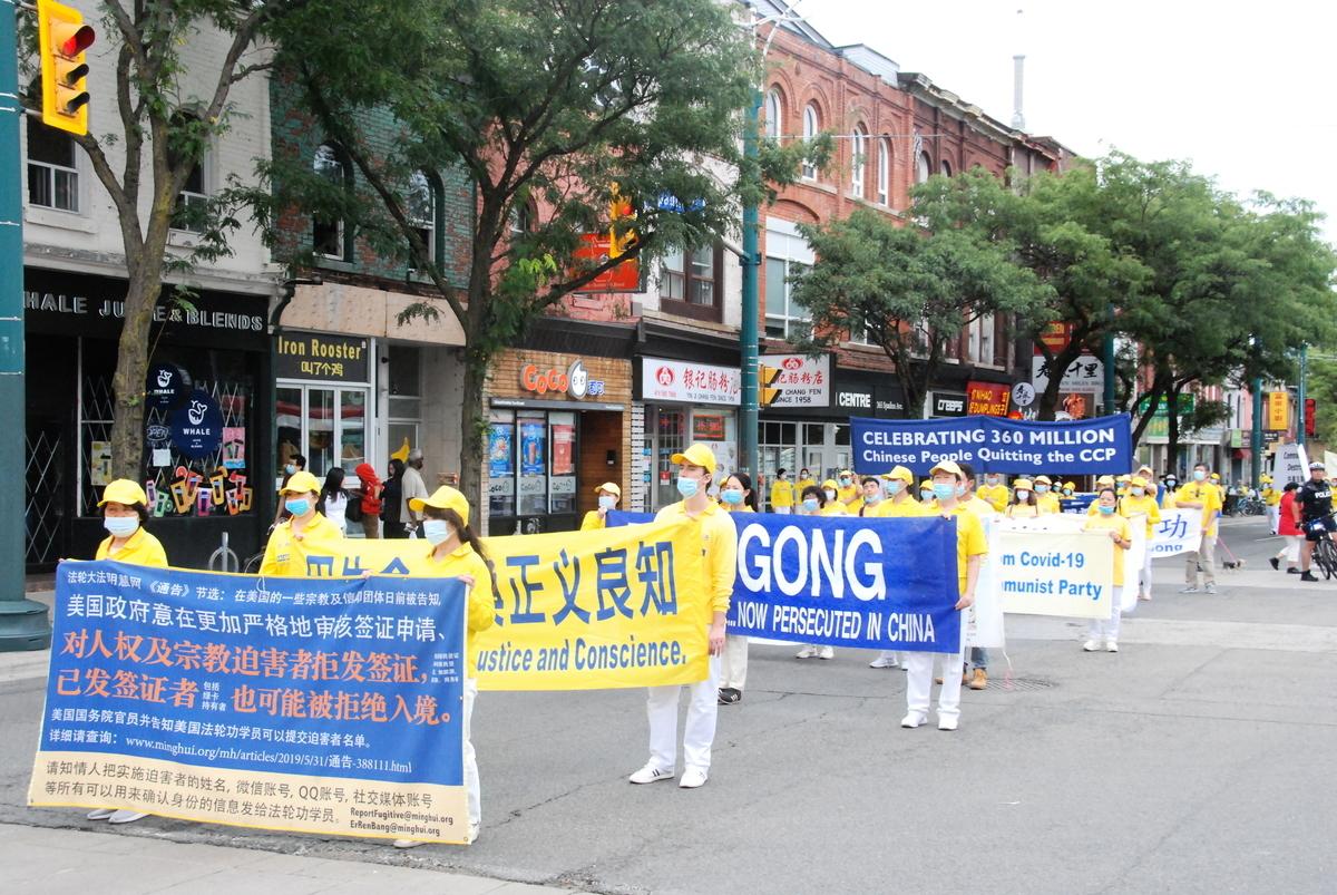 2020年9月5日下午,大多倫多地區法輪功學員在市中心舉行集會、遊行,抗議中共對大陸法輪功學員的「清零行動」,呼籲各國政府發聲,制止迫害,解體中共。(伊鈴/大紀元)