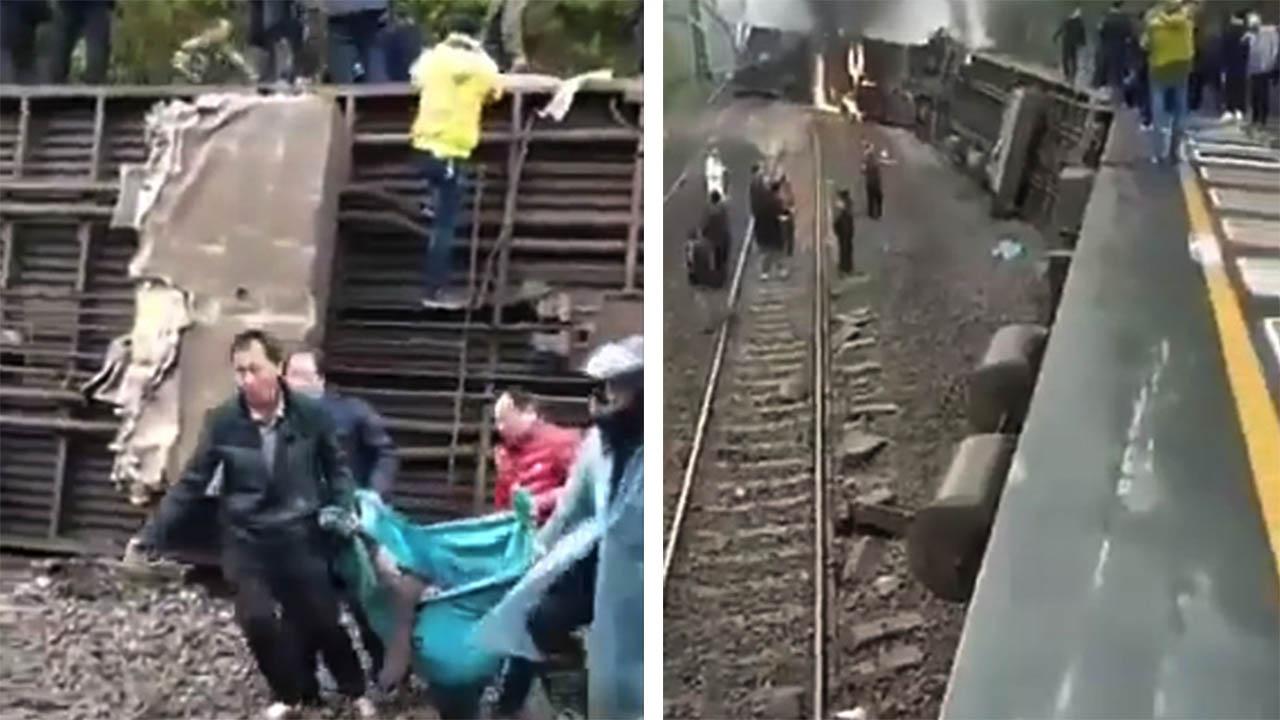 湖南郴州客運火車遇山泥傾瀉,致多節車廂脫軌傾覆。事發前一名村民向當地派出所多次報警,但無果。網民上傳影片顯示,現場有人清理死者遺體。(影片截圖)
