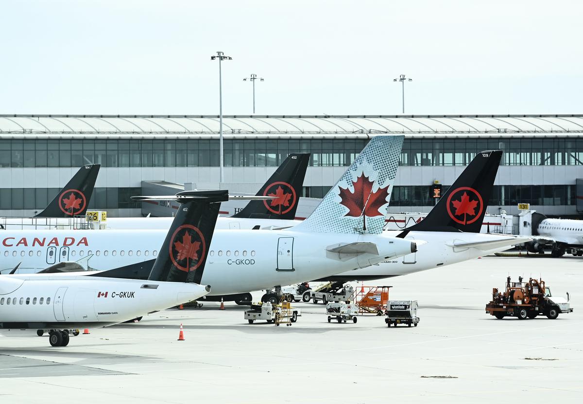 加航宣佈再裁員1,500人,並暫停了更多的國際航班。(Nathan Denette/加通社)