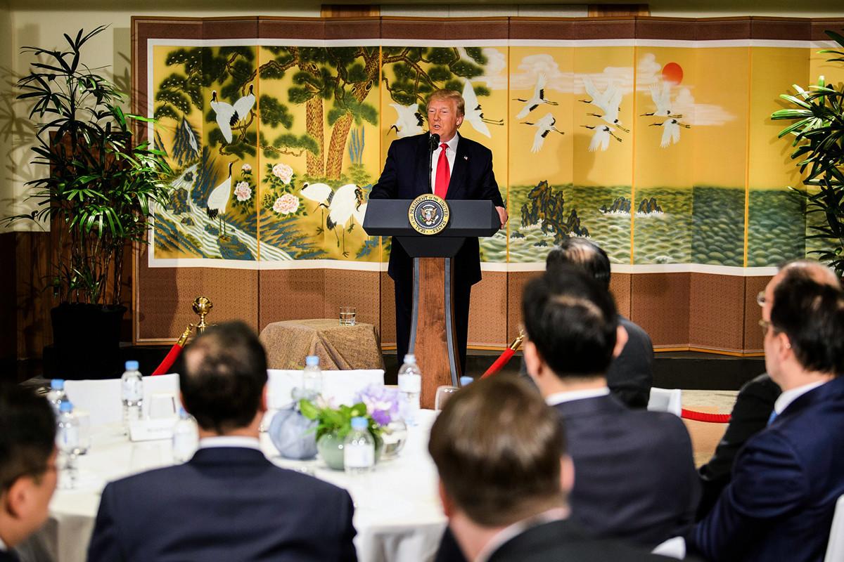 6月30日上午,特朗普總統向南韓商業領袖講話。他表示,在達成中美貿易協議之前,不會取消已經施加的對華關稅。(Brendan Smialowski / AFP)