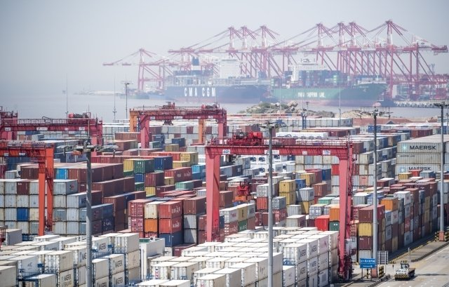 美中貿易戰持續升溫,台商擔憂,紛紛撤出中國。圖為示意照。(AFP)