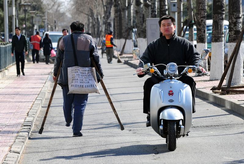曾擔任美國眾議院議長貝納幕僚的清華大學教授程致宇認為,中國經濟國進民退,若不扭轉,類似六四的事件可能重演。圖為2011年3月22日,北京市一景。(AFP/Getty Images)