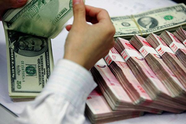 在過去幾周,中美之間緊張局勢加劇,金融市場預期中美摩擦將進一步升級,市場避險情緒加強,美元指數上漲。(STR/AFP/Getty Images)