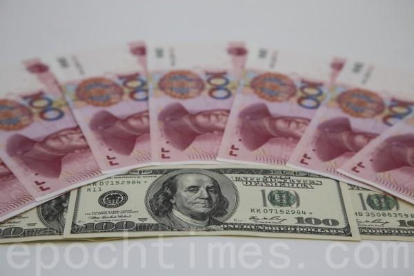 12月5日人民幣一度急遽貶值。(余鋼/大紀元)