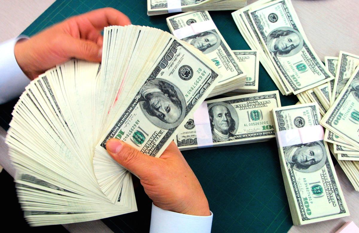 雅虎金融網2月26日數據顯示,美元/日圓(USD/JPY)價格在周五(美東時間2月26日)強勁上漲。(Chung Sung-Jun/Getty Images)
