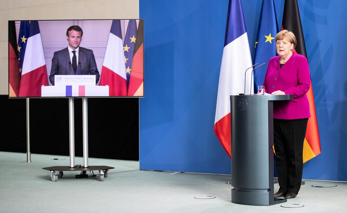 2020年5月18日,法國總統馬克龍和德國總理默克爾通過電視舉行記者會。(Andreas Gora - Pool/Getty Images)