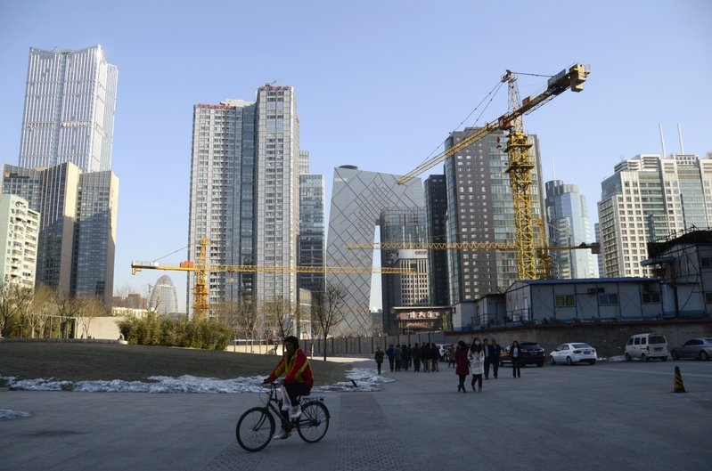 大陸房企資金鏈堪憂,融資成本大幅上升,房企選擇降價銷售。(WANG ZHAO/AFP)