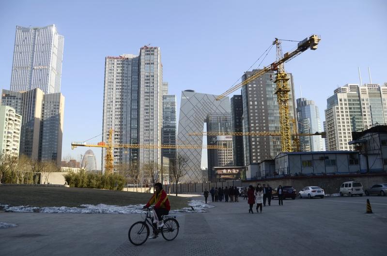 有業界人士表示,大陸房企面臨資金壓力將在3月份顯現。圖為資料照。(WANG ZHAO/AFP)