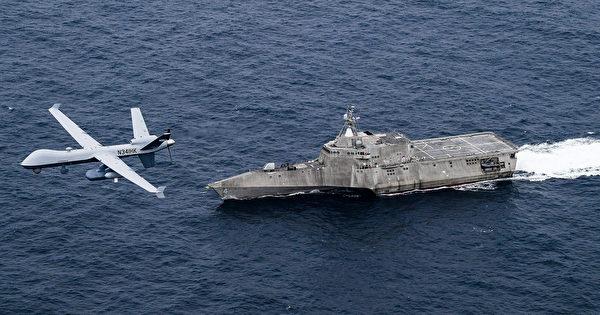 2021年4月21日,美軍MQ-9無人機與濱海戰鬥艦科羅納多號(LCS 4)在太平洋演練。中共海軍還沒有適應低端航母的作戰,美軍已經著眼於未來海戰。(美國海軍)
