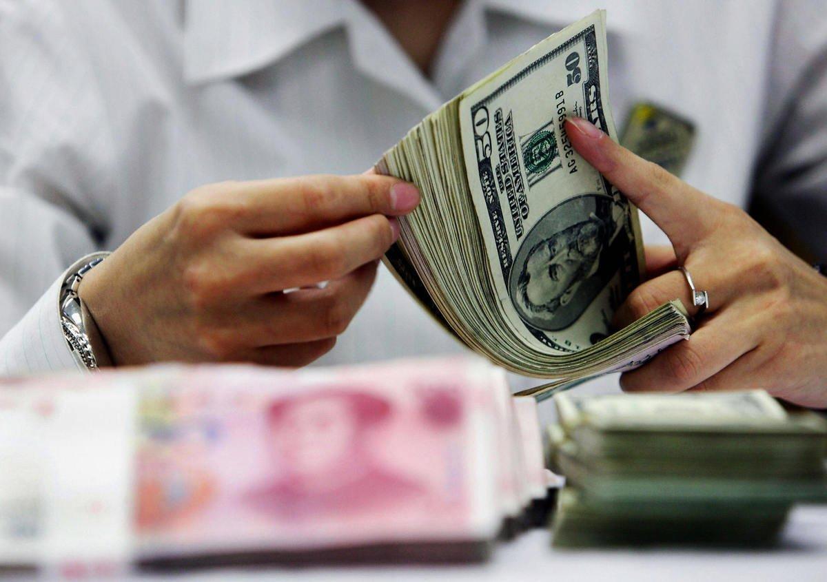中國的外匯儲備規模近年來一直穩居世界第一。不過,在當前境況下,時時有崩潰的風險。(STR/AFP/Getty Images)