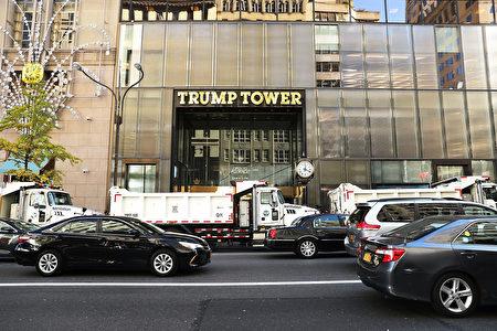 團團圍住特朗普大樓的環保車。(Spencer Platt/Getty Images)