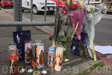 12月4日,奧克蘭市民在火災現場獻上花束和蠟燭悼念死者。(林驍然/大紀元)