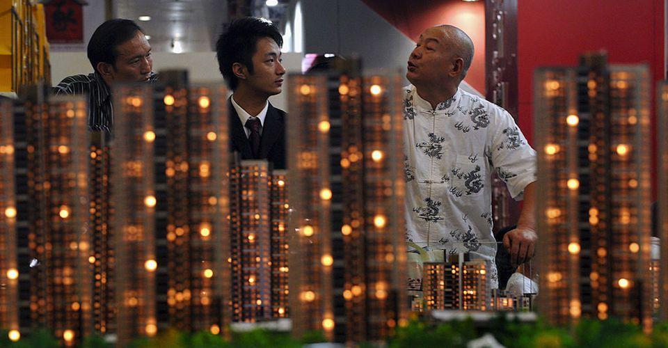 房地產行業的資金面正面臨嚴峻的考驗。地產商正想方設法銷售房產,以加速銷售回款。(China Photos/Getty Images)