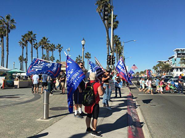 11月28日,加州民眾在杭廷頓海灘(Huntington Beach)舉行「停止竊選」集會,同時支持特朗普總統。(新唐人電視台)