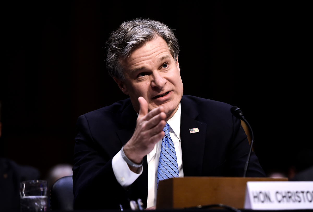 聯邦調查局(FBI)局長克里斯托弗·雷(Christopher Wray)7月7日發表講話說,FBI每大約10小時就會啟動一起中共相關反間諜案。(Photo by Olivier Douliery / AFP)