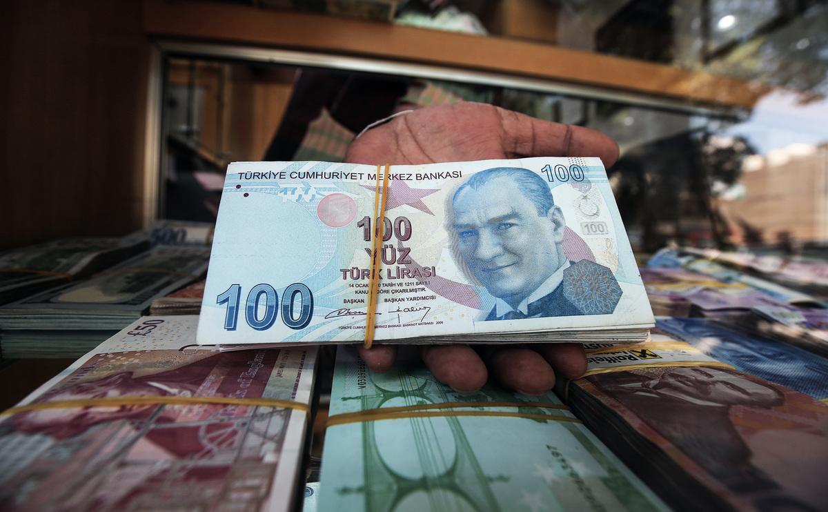 土耳其貨幣里拉幣值暴跌,引發全球關注,各界擔心是否會引發更大危機。(AFP)