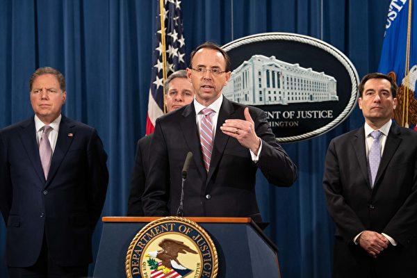 12月20日美國司法部對進行全球網絡攻擊活動的兩名中國黑客提出指控。圖為美國司法部副部長羅森斯坦(Rod J. Rosenstein)等在12月20日的新聞發佈會現場。(NICHOLAS KAMM/AFP)
