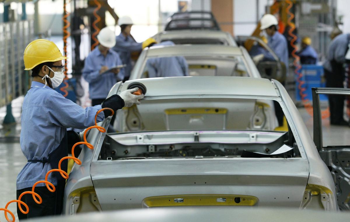 截至4月7日,已公佈年報的大陸13家上市車企負債合計高達8656.12億元人民幣,同比增長11%;平均負債率為66.15%。(Photo by China Photos/Getty Images)