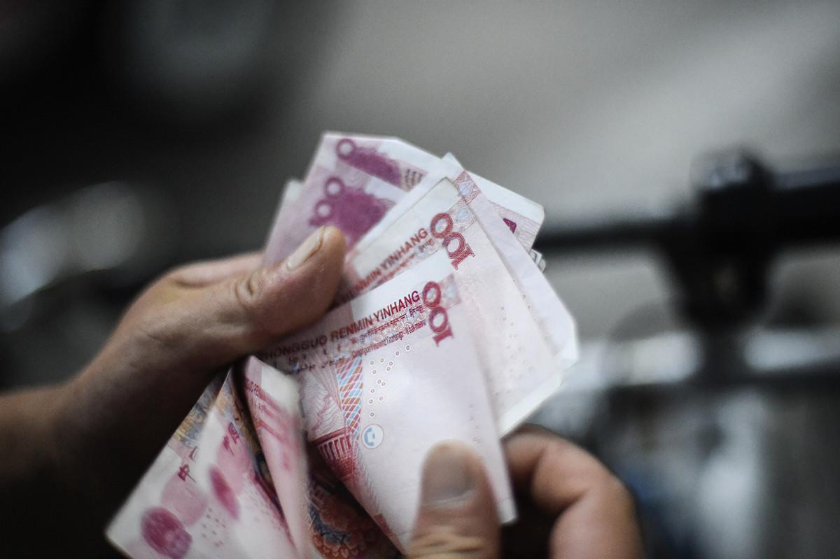 據中共官方的數據顯示,截至2月,中國金融系統中流通著約2,110億美元的欠條。(AFP)