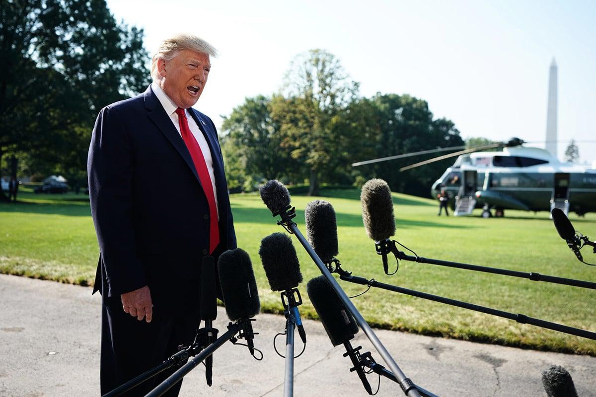 8月7日,特朗普總統在白宮南草坪發表講話,談及中美貿易戰的問題。(MANDEL NGAN/AFP)