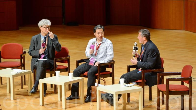 去年11月28日出席香港學術峰會的賀建奎(中)曾在演講中為自己的研究辯護。(宋碧龍/大紀元)