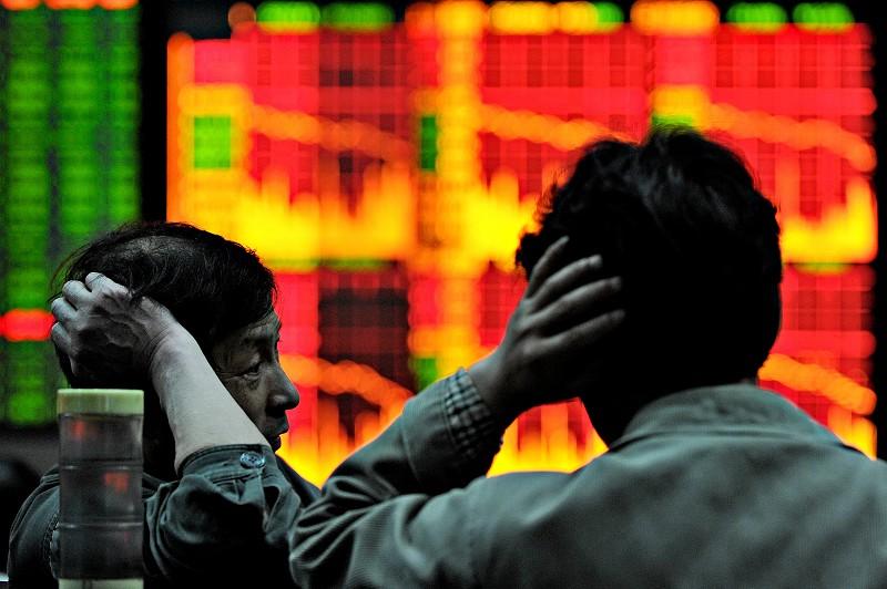 大陸股市10日午後跳水下跌,隨後「國家隊」進場托市。圖為資料照。(AFP)