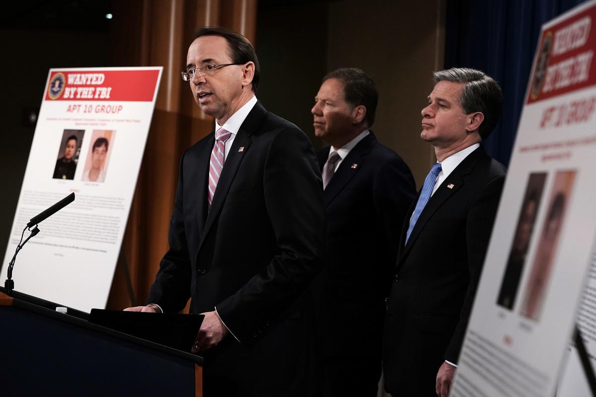 繼五眼聯盟,日本亦譴責中共黑客攻擊。圖為美國司法部12月20日宣佈起訴兩名為中共國安部服務的中國黑客。(Alex Wong/Getty Images)