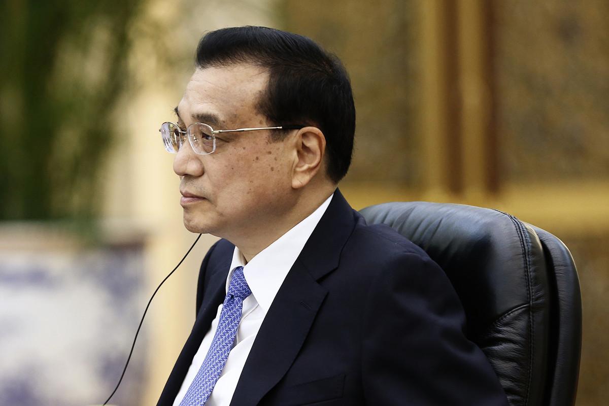 習特會後,周二(7月2日),李克強承諾加快中國金融業開放步伐,外媒認為,這是中方的一個讓步跡象,但中共是否能兌現承諾是個問題。(Florence Lo - Pool/Getty Images)