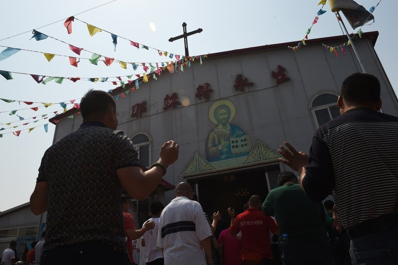 中共持續打壓宗教和信仰團體。圖為大陸地方教會。(Greg BAKER/AFP)