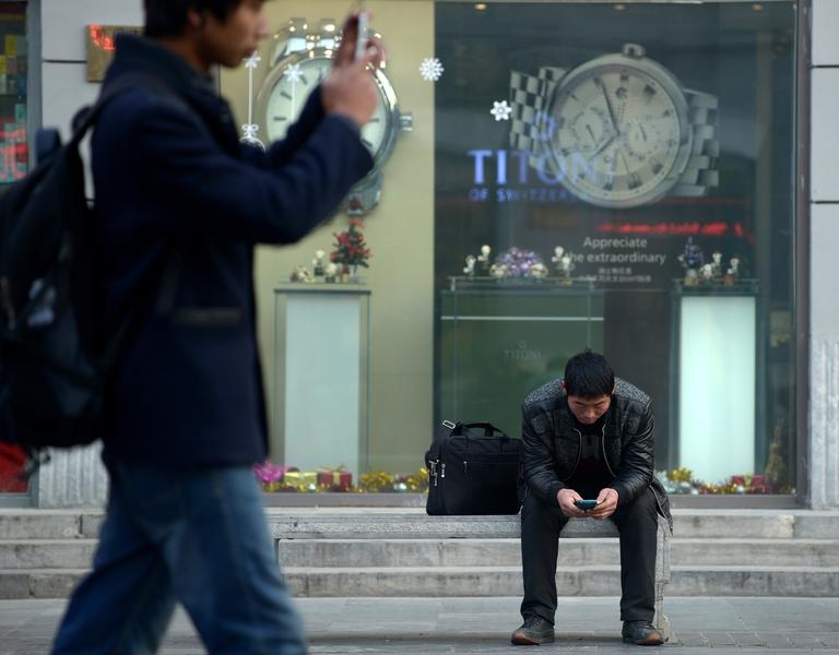 在中共聲稱「脫貧」之後,中共官媒高調稱「江西省成為第一個全面取消城市落戶限制的省份」。圖為北京街頭一景。(WANG ZHAO/AFP/Getty Images)