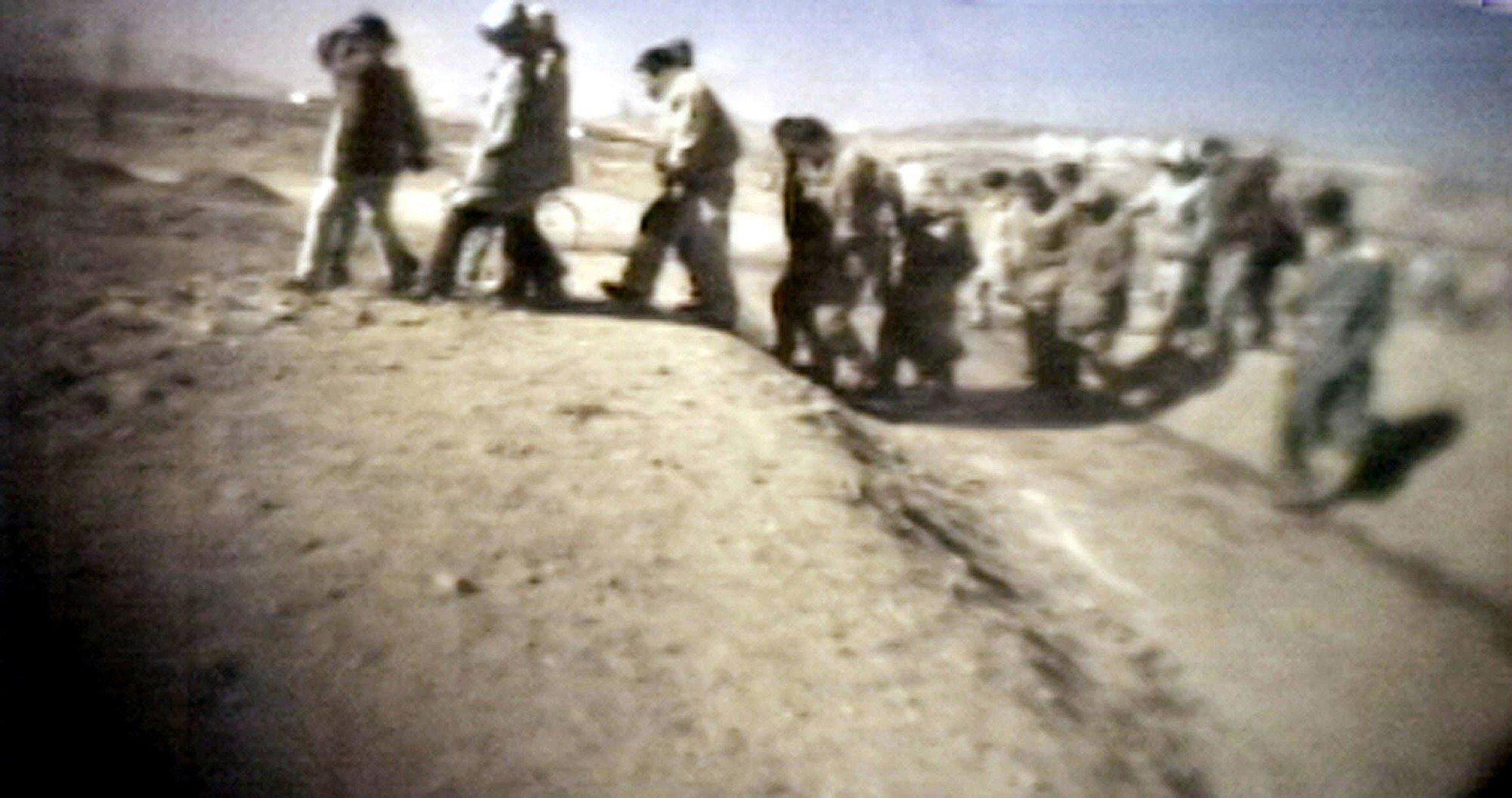 自由亞洲電台援引消息說,北韓勞改營內的非人道生活每況愈下,但當局卻視而不見。圖為2005年3月16日,日本一家電視台所播出的北韓囚犯被公開處決的畫面。(AFP/JIJI PRESS)