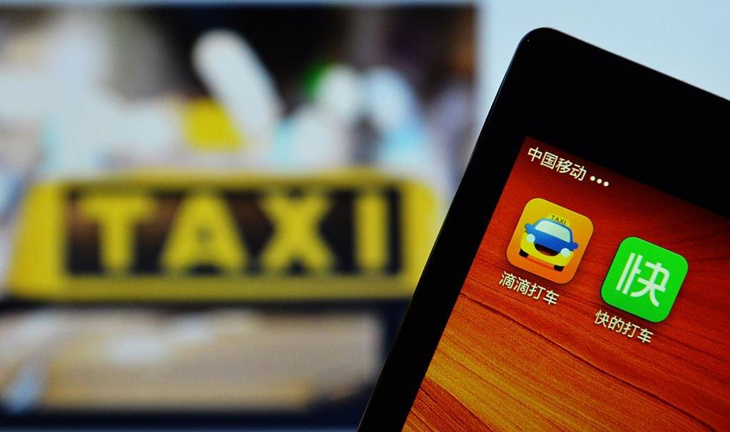 滴滴出行申請在美國IPO(首次公開招股)之際,中國市場監管當局已經對這家叫車巨頭展開反壟斷調查。(STR/AFP/Getty Images)