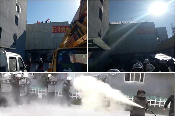 1月21日上午,北京昌平肯特公寓小區闖入百餘手持盾牌的黑衣保安將小區戒嚴,另有三輛挖掘機和吊車到現場準備強拆。近七十名業主拚死抵抗,有老婦欲跳樓後被勸下。(業主提供)