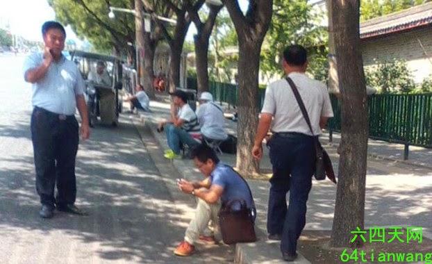 示意圖。圖為2014年8月,北京三辦胡同外的維權人士。(六四天網)