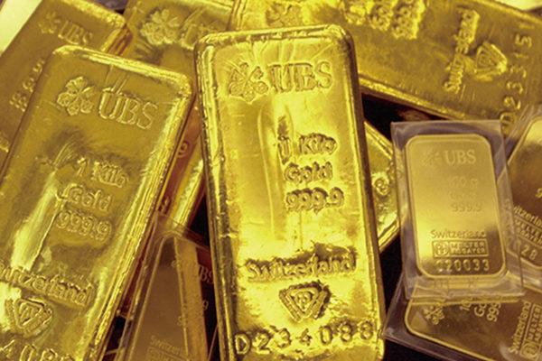 美銀報告預期金價未來18個月可漲到每安士3,000美元。(JUNG YEON-JE/AFP/Getty Images)