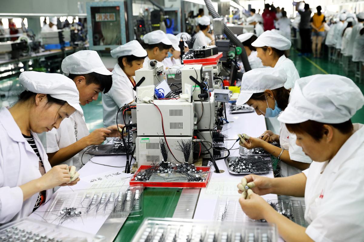 中美貿易戰已經持續到第二年,造成的一個明顯的結果是,大批美國公司正在將生產轉移到中國以外的國家,且這個趨勢是不可逆轉的。圖為示意照。(AFP)